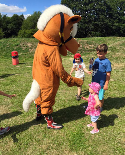 Mascot playing with children