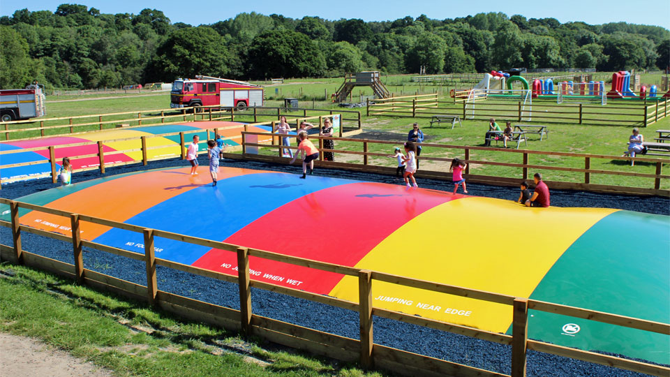 Outdoor-play-on-the-giant-inflatable-pillows-image-1